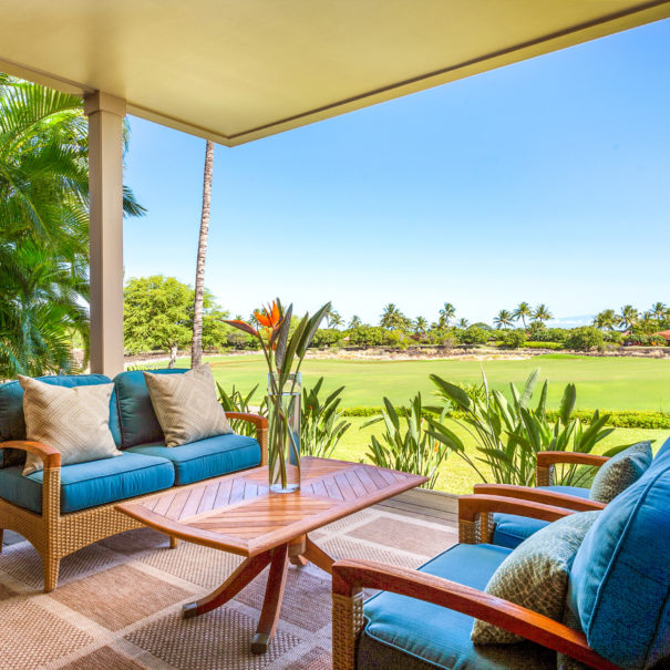 Outdoor furniture on wooden lanai overlooking golf course
