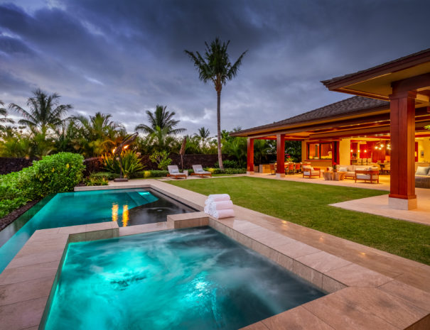 Lit up spa and pool at twilight with Hualalai Resort Home lit up