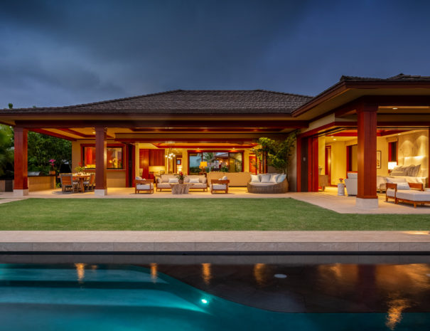 Lit up pool at twilight with Hualalai Resort Home lit up