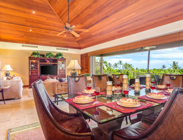 Set dining table showing high ceilings and comfortable living room and beautiful tropical views past open sliding door