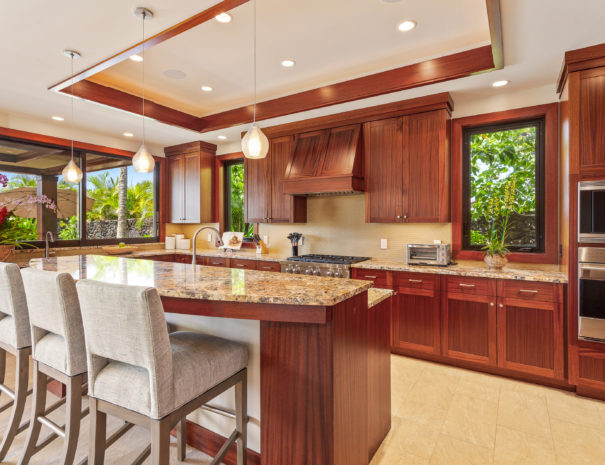 Luxurious kitchen area with three bar stools