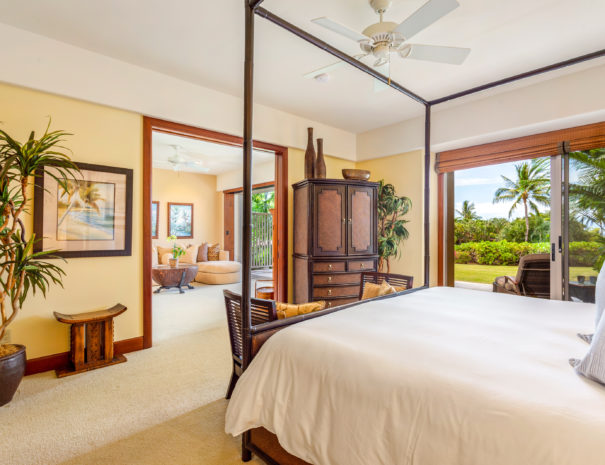 Artfully decorated and carpeted master bedroom showing retreat past interior sliding doors and beautiful lanai past exterior sliding door