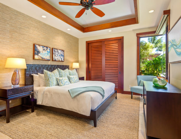 Carpeted bedroom with white covers and teal